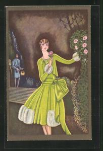 AK Art Deco, Dame im grünen Kostüm steht an Rosenbusch, Herr mit Zylinder nähert sich