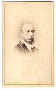 Fotografie T. & J. Holroyd, Harrogate, Portrait älterer Herr Herr im Anzug mit Fliege u. Bart
