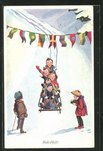 Künstler-AK Schlitten, fünf Kinder in einem Bob fahren unter Wimpelkette, Bob-Heil!
