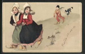 AK holländische Mädchen und Jungen in Trachten laufen Schlittschuh