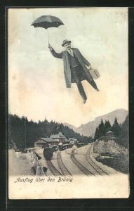AK Brünig, Fliegender Mensch mit Schirm über dem Bahnhof