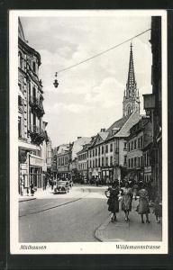 AK Mülhausen, Wildemannstrasse, Blick auf Kirchturm und Geschäftsfassaden