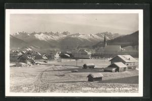 AK Seefeld i. T., Ortspartie mit Kalkkögel im Winter