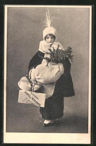 AK Bepackte Puppe in Winterkleidung mit Tannenzweigen