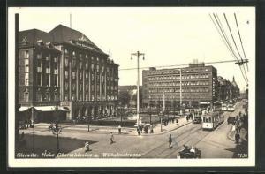 AK Gleiwitz, Haus Oberschlesien und Wilhelmstrasse mit Strassenbahnen