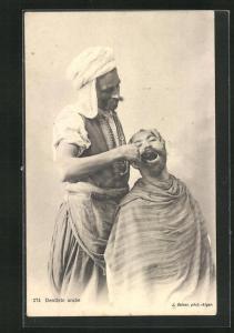 AK Arabischer Zahnarzt behandelt einen Patienten, arabische Volkstypen