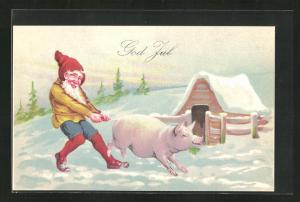 AK Zwerg hält Schwein mit Kleeblatt fest, Winter, God Jul