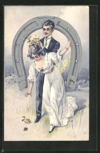Präge-AK Junges Paar unterm Hufeisen