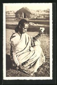 AK Filatura del cotone, afrikanische Händlerin mit Spindel