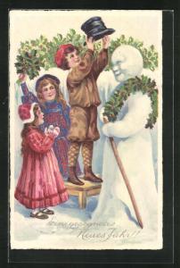 AK Kinder bauen einen Schneemann, Neujahrsgruss
