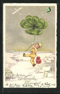 AK Fallschirmspringer segelt am riesigen Kleeblatt zur Erden, Neujahrsgruss