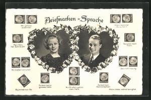 AK Briefmarkensprache, Paar in Herzen