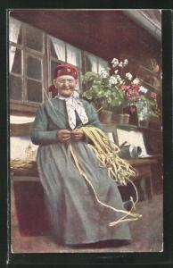 AK Frau in Schwarzwälder Tracht beim Korbflechten, Heimarbeit