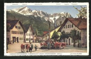 AK Garmisch-Partenkirchen, Floriansplatz gegen Zugspitzgruppe mit Höllental, Zugspitze und Waxenstein