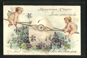 Präge-Lithographie Heureuses Pâques, Osterengel mit Wippe