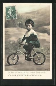 AK Kleines Kind auf seinem Fahrrad
