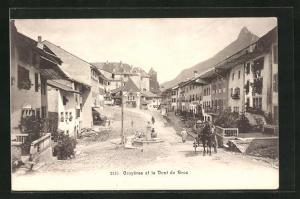 AK Gruyeres, Ortspartie mit Brunnen und Pferdekutsche, Dent du Broc