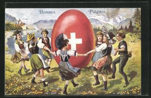 AK Schweiz, Schweizer in Tracht umtanzen ein riesiges Osterei