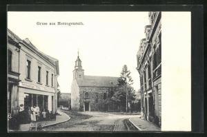 AK Herzogenrath, Strassenpartie mit Blick zur Pfarrkirche