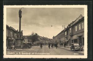 Foto-AK Eisenstadt, Hauptstrasse mit Dreifaltigkeitssäule und Eisenhandlung Ignaz König