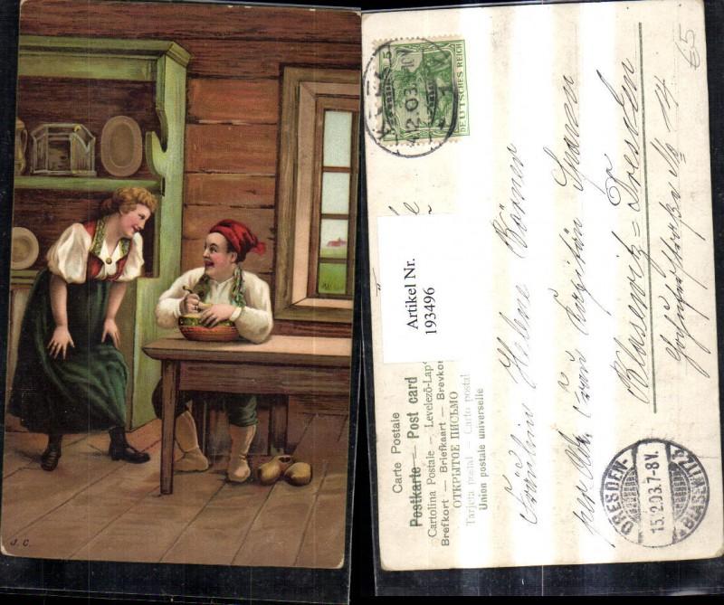 Mann b. Essen Löffel Frau in Tracht Pantoffeln Tisch