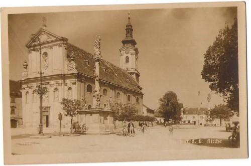 16386;Strassenpartie Bruck a.d. Leitha Kirche Leute