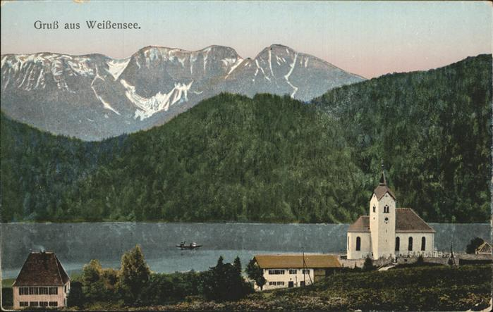Weissensee Fuessen Ortsansicht mit Kirche Blick auf den See Kat. Fuessen