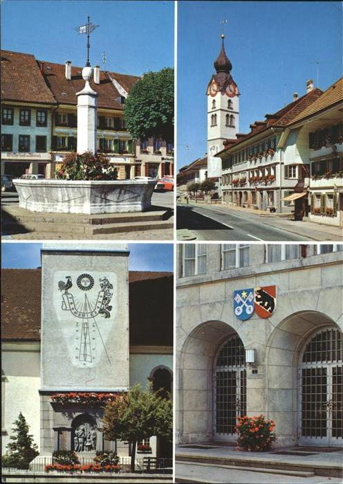 Huttwil Brunnenplatz Sonnenuhr Soldatendenkmal Marktgasse Stadthauseingang Wappen Das Blumenstaedtchen im Emmental Kat. Huttwil