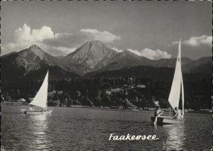 Faak am See Finkenstein Faakersee Segelboot Mittagskogel Tuerkenkopf Karawanken Kat. Finkenstein am Faaker See