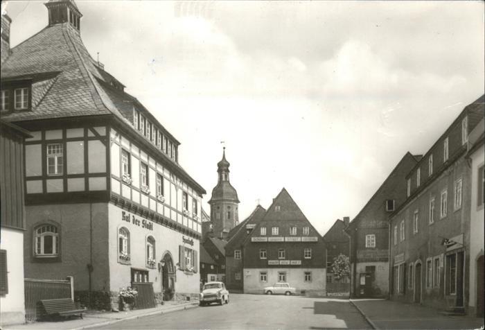 Geising Erzgebirge Hauptstrasse mit Rathaus und Kirche