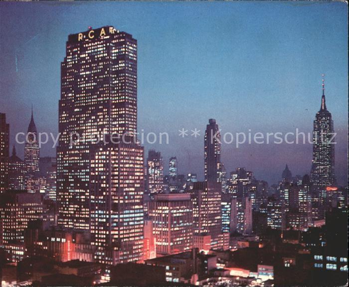 New York City Night falls on Midtown Manhattan RCA Building Chrysler Building Empire State Building / New York /