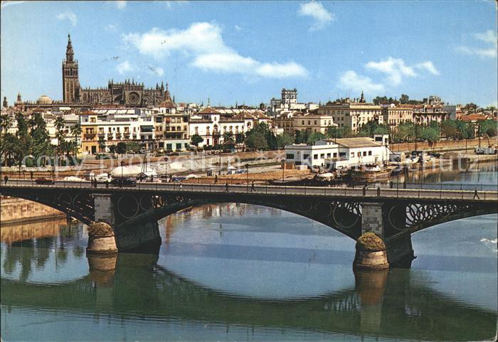 Sevilla Andalucia Puerto de Triana y vista parcial Catedral Kat. Sevilla