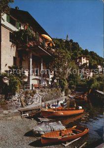 AK / Ansichtskarte Porto Ronco Haeuserpartie am Wasser mit Blick zur Kirche Kat. Porto Ronco