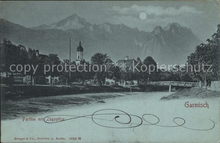 AK / Ansichtskarte Garmisch Partenkirchen Ortspartie mit Kirche und Zugspitze im Mondschein Kat. Garmisch Partenkirchen