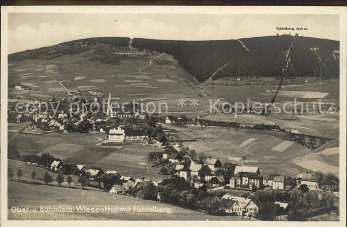 AK / Ansichtskarte Oberwiesenthal Erzgebirge mit Boehmisch Wiesenthal und Fichtelberg Kat. Oberwiesenthal