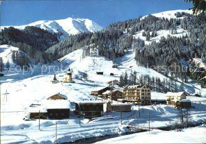 AK / Ansichtskarte Frauenkirch GR mit Hotel Post und Frauenkirchli Winterpanorama Kat. Davos