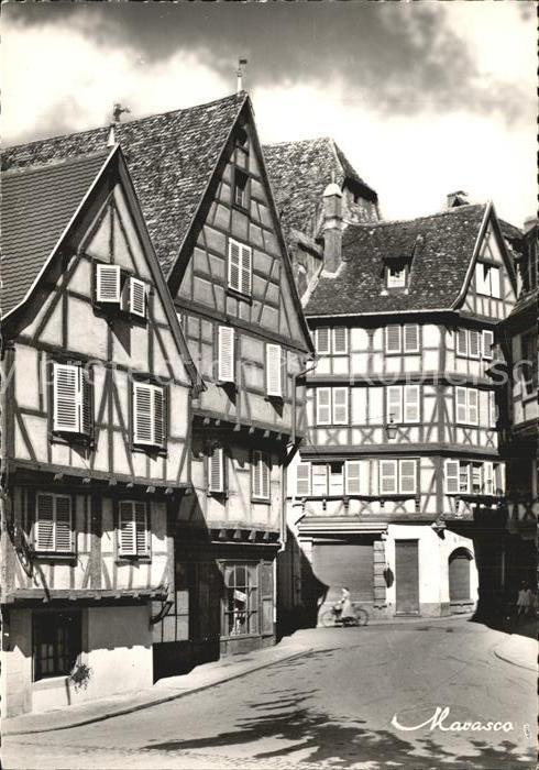 AK / Ansichtskarte Colmar Haut Rhin Elsass Rue des Marchands vieilles maisons Fachwerkhaeuser Kat. Colmar