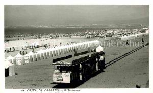 AK / Ansichtskarte Costa da Caparica O Transpraia Touristenbahn Strand
