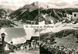 AK / Ansichtskarte St Anton Arlberg Ortsmotiv mit Kirche Galzigbahn Bergbahn Vallugabahn Alpenpanorama Kat. St. Anton am Arlberg