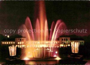AK / Ansichtskarte Bad Lippspringe Kurhaus mit Leuchtfontaene bei Nacht Kat. Bad Lippspringe