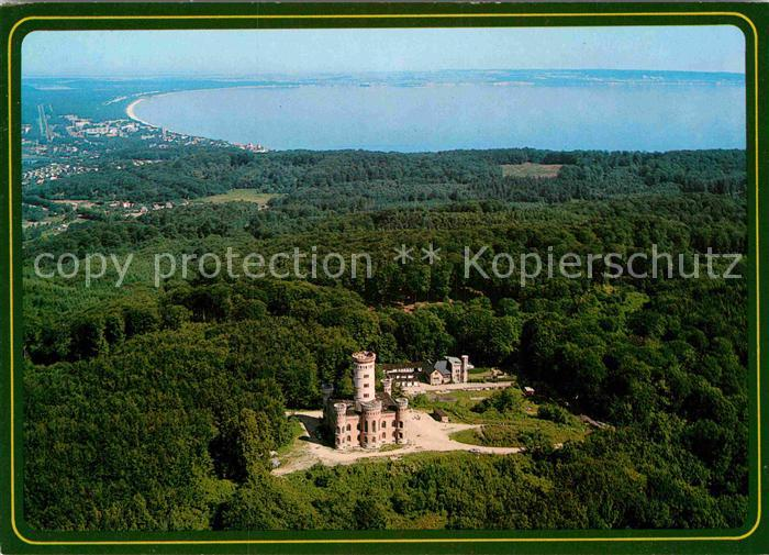 AK / Ansichtskarte Granitz Ruegen Jagdschloss mit Blick auf Ostseebad Binz Fliegeraufnahme