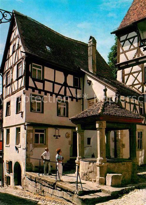 AK / Ansichtskarte Rothenburg Tauber Brunnen in der Hofbronnengasse Fachwerkhaus Kat. Rothenburg ob der Tauber