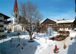 AK / Ansichtskarte Seefeld Tirol Dorfplatz mit Kirche Kat. Seefeld in Tirol