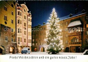 AK / Ansichtskarte Innsbruck Goldenes Dachl Christbaum Weihnachtskarte Nachtaufnahme Kat. Innsbruck