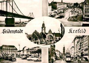AK / Ansichtskarte Krefeld Ostwall Rheinbruecke Rheinstrasse Bahnhofsvorplatz Kat. Krefeld
