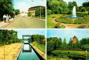 AK / Ansichtskarte Neustadt Glewe Rudolf Breitscheid Strasse Springbrunnen Schleuse Burg Kat. Neustadt Glewe