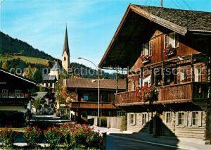 AK / Ansichtskarte Kirchberg Tirol Strassenpartie Kirche Kat. Kirchberg in Tirol