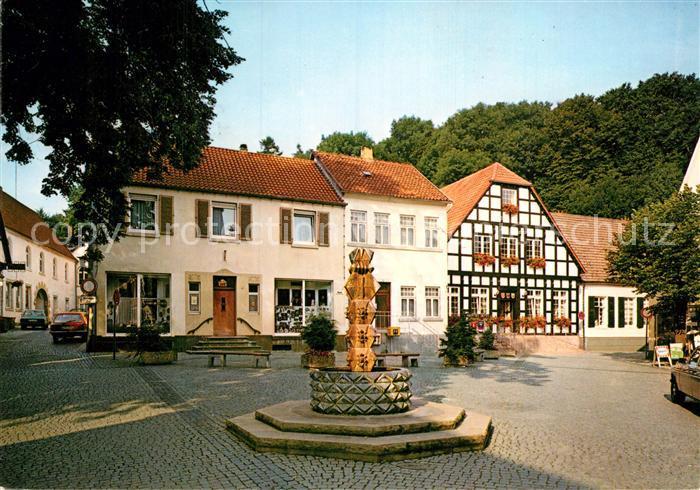 AK / Ansichtskarte Tecklenburg Marktplatz Brunnen Fachwerkhaus Kat. Tecklenburg