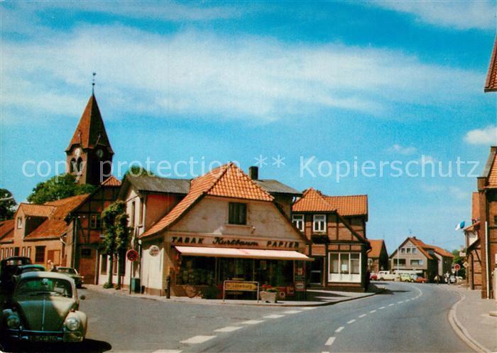 AK / Ansichtskarte Dahlenburg Hauptstrasse Ladengeschaeft Kirchturm Kat. Dahlenburg