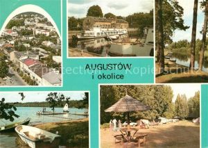 AK / Ansichtskarte Augustow Teilansicht Badestrand am See Bootsanleger Campingplatz